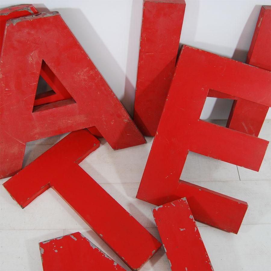 Tilt Originals - Red metal letters